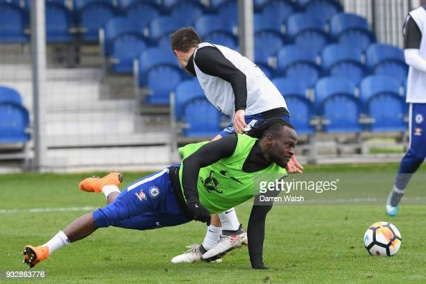 Cesar Azpilicueta and Victor Moses of Chelsea during a training session at Chelsea Training Ground on March 16 2018 in Cobham United Kingdom
