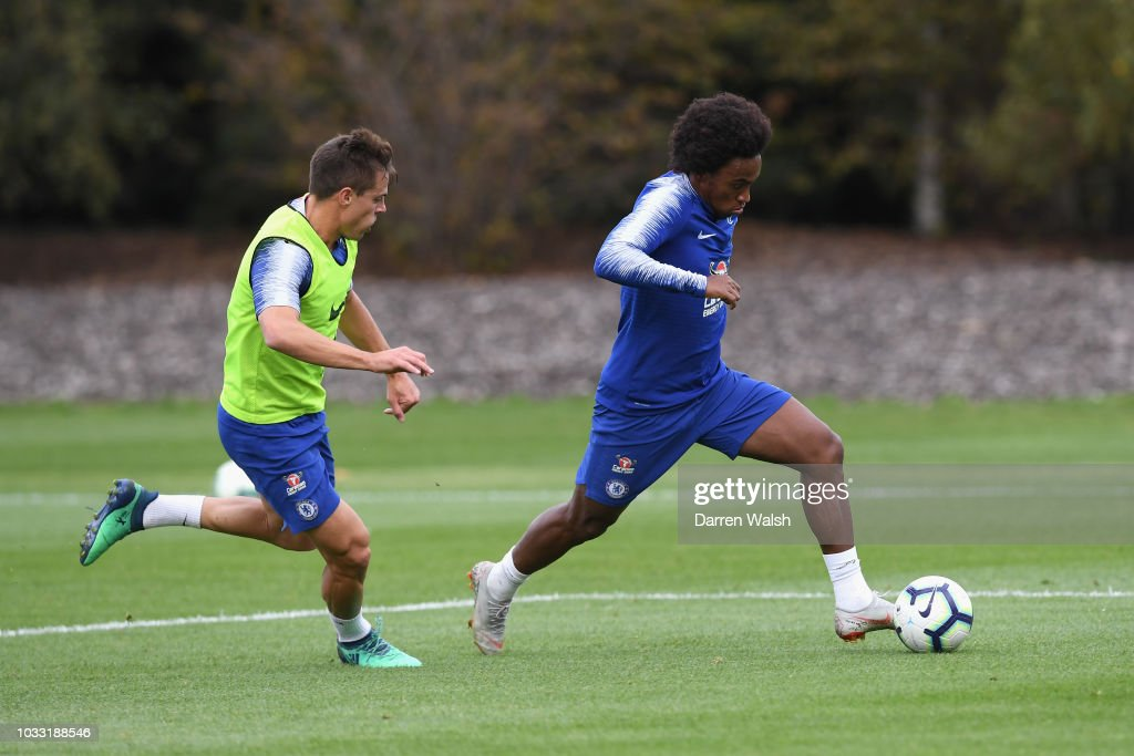 Cesar Azpilicueta and Willian of Chelsea during a training session at Chelsea Training Ground on September 14, 2018 in Cobham, England.