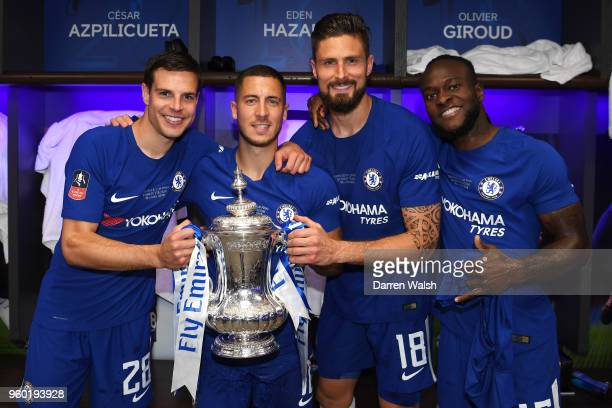 Cesar Azpilicueta Eden Hazard Olivier Giroud and Victor Moses of Chelsea pose with the Emirates FA Cup trophy following their sides victory in The...