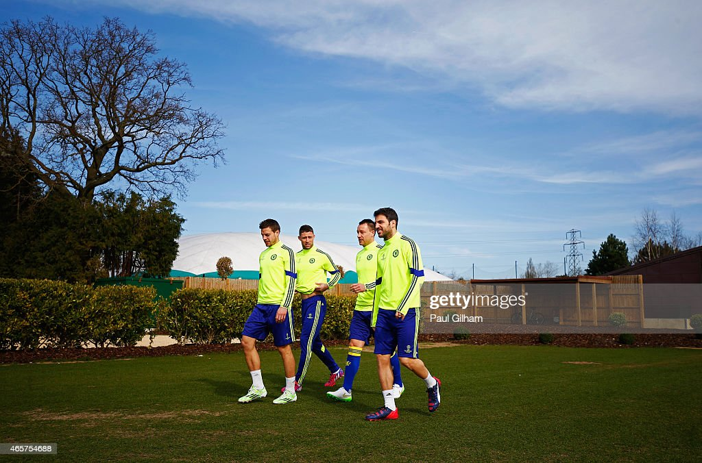 Cesar Azpilicueta, Gary Cahill, John Terry and Cesc Fabregas of Chelsea walk to the pitch during a Chelsea training session ahead of the UEFA Champions League Round of 16 second leg match against Paris Saint-Germain at Chelsea Training Ground on March 10, 2015 in Cobham, England.