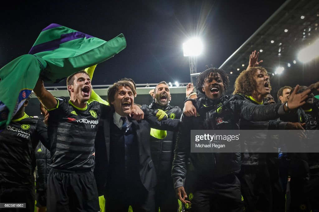 Cesar Azpilicueta, manager Antonio Conte, Nathaniel Chalobah and David Luis of Chelsea celebrate winning the league after the Premier League match between West Bromwich Albion and Chelsea at The Hawthorns on May 12, 2017 in West Bromwich, England. Chelsea are crowned champions after a 1-0 victory against West Bromwich Albion.