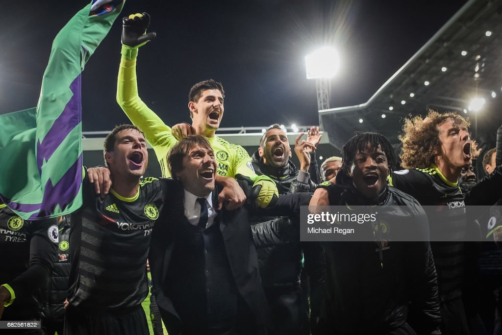 Cesar Azpilicueta, manager Antonio Conte, Thibaut Courtois, Nathaniel Chalobah and David Luis of Chelsea celebrate winning the league after the Premier League match between West Bromwich Albion and Chelsea at The Hawthorns on May 12, 2017 in West Bromwich, England. Chelsea are crowned champions after a 1-0 victory against West Bromwich Albion.