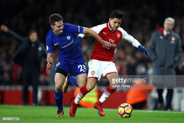 Cesar Azpilicueta of Chelsea and Alexis Sanchez of Arsenal battle for possession during the Premier League match between Arsenal and Chelsea at...