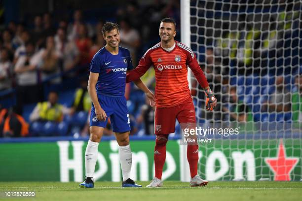 Cesar Azpilicueta of Chelsea and Anthony Lopes of Lyon hug each other after the preseason friendly match between Chelsea and Lyon at Stamford Bridge...