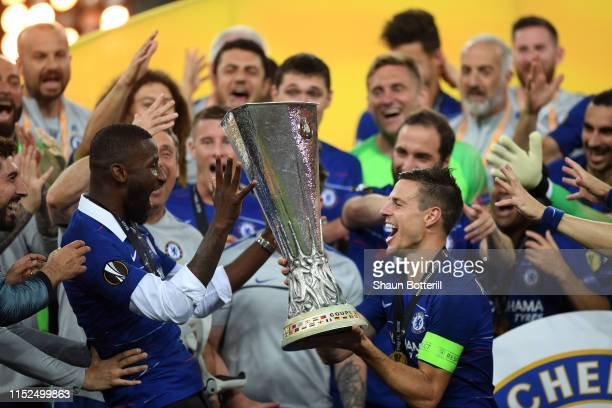 Cesar Azpilicueta of Chelsea and Antonio Ruediger of Chelsea celebrates with the Europa League Trophy following their team's victory in the UEFA...