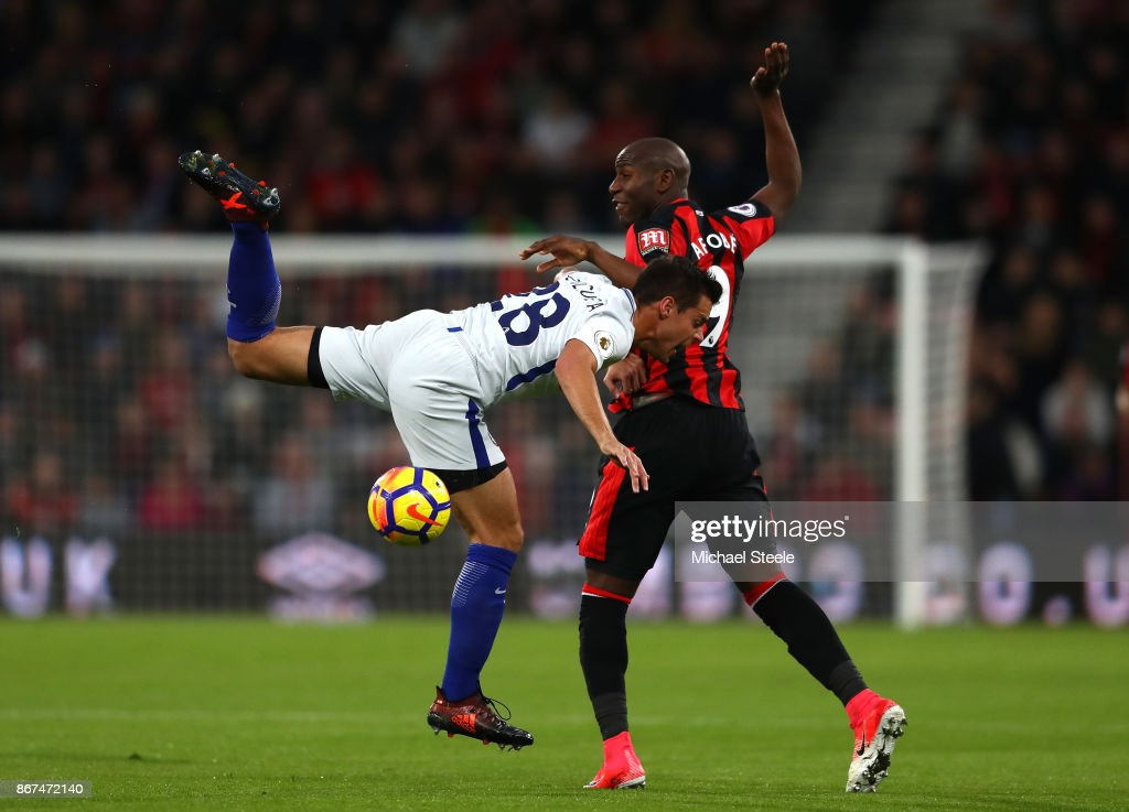 Cesar Azpilicueta of Chelsea and Benik Afobe of AFC Bournemouth battle for possession during the Premier League match between AFC Bournemouth and Chelsea at Vitality Stadium on October 28, 2017 in Bournemouth, England.