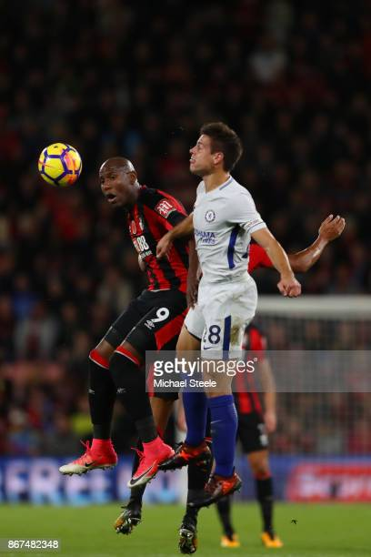 Cesar Azpilicueta of Chelsea and Benik Afobe of AFC Bournemouth battle for possession in the air during the Premier League match between AFC...