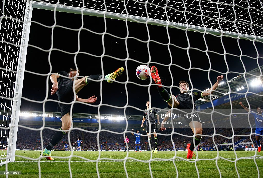 Cesar Azpilicueta of Chelsea (R) and Gary Cahill of Chelsea (L) attempt to stop the ball crossing the line as Shinji Okazaki of Leicester City scores his sides first goal during the EFL Cup Third Round match between Leicester City and Chelsea at The King Power Stadium on September 20, 2016 in Leicester, England.
