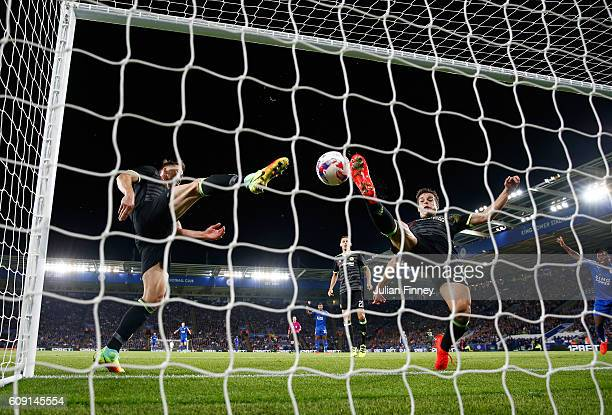 Cesar Azpilicueta of Chelsea and Gary Cahill of Chelsea attempt to stop the ball crossing the line as Shinji Okazaki of Leicester City scores his...