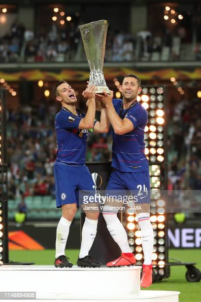 Cesar Azpilicueta of Chelsea and Gary Cahill of Chelsea lift the trophy after winning the UEFA Europa League Final between Chelsea and Arsenal at...