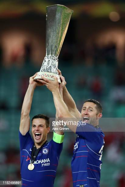 Cesar Azpilicueta of Chelsea and Gary Cahill of Chelsea lift the Europa League Trophy following their victory in the UEFA Europa League Final between...