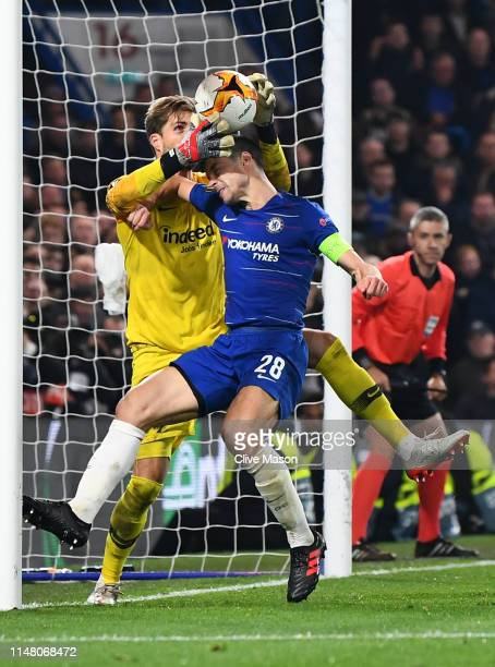 Cesar Azpilicueta of Chelsea and Kevin Trapp of Eintracht Frankfurt challenge for the ball on the goal line which leads to a disallowed goal for...
