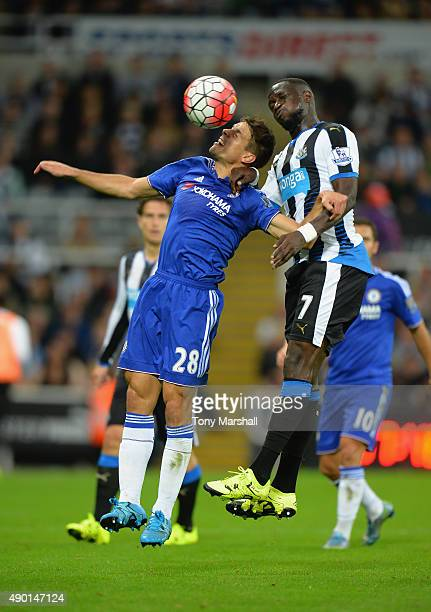 Cesar Azpilicueta of Chelsea and Moussa Sissoko of Newcastle United compete for the ball during the Barclays Premier League match between Newcastle...