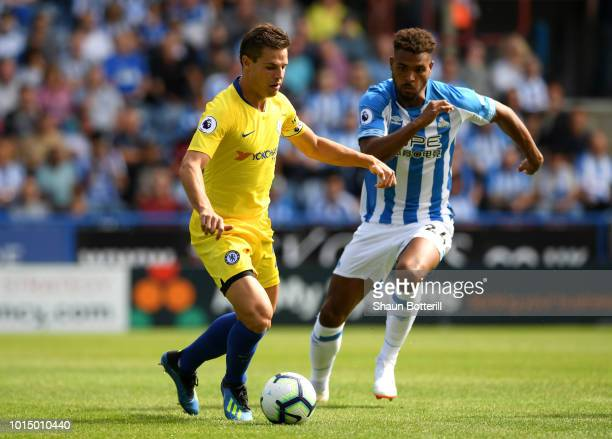 Cesar Azpilicueta of Chelsea and Steve Mounie of Huddersfield Town during the Premier League match between Huddersfield Town and Chelsea FC at John...