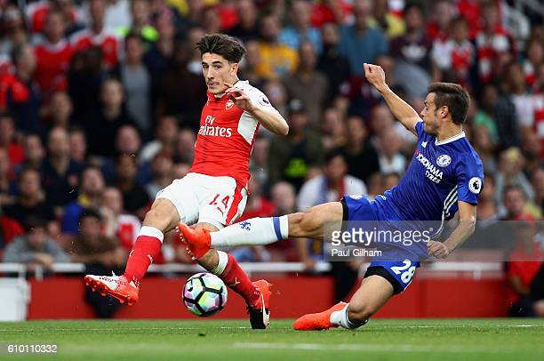 Cesar Azpilicueta of Chelsea attempts to block Hector Bellerin of Arsenal cross during the Premier League match between Arsenal and Chelsea at the...