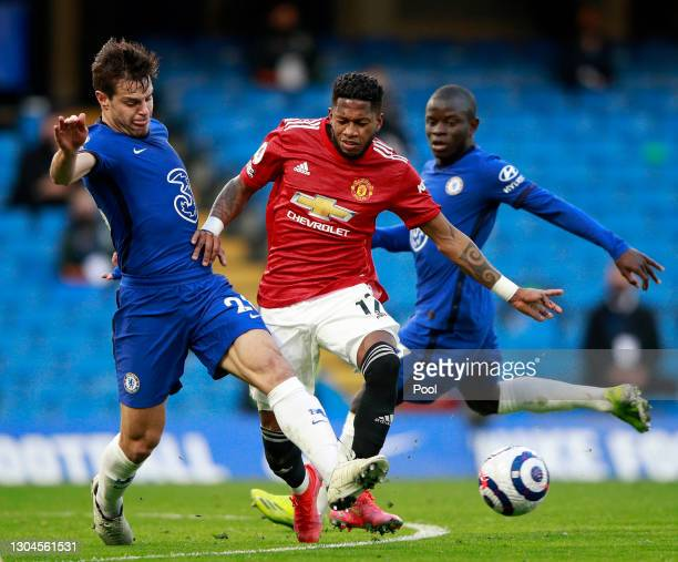 Cesar Azpilicueta of Chelsea battles for possession with Fred of Manchester United during the Premier League match between Chelsea and Manchester...