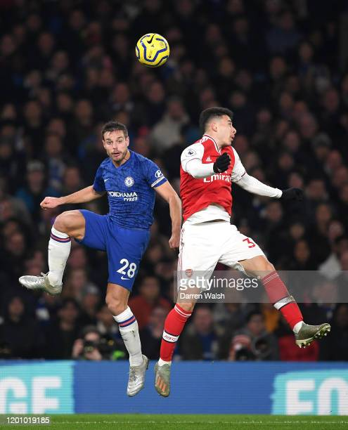 Cesar Azpilicueta of Chelsea battles for possession with Gabriel Martinelli of Arsenal during the Premier League match between Chelsea FC and Arsenal...