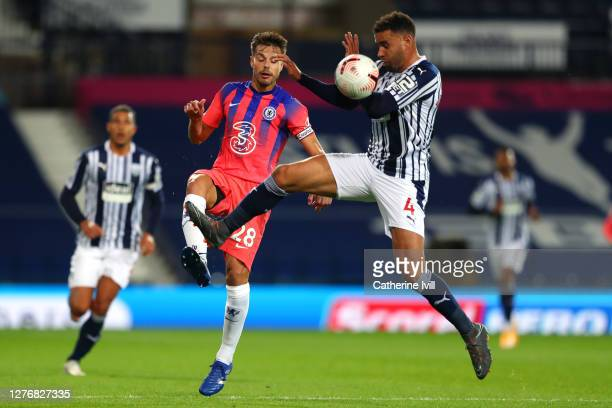 Cesar Azpilicueta of Chelsea battles for possession with Hal RobsonKanu of West Bromwich Albion during the Premier League match between West Bromwich...