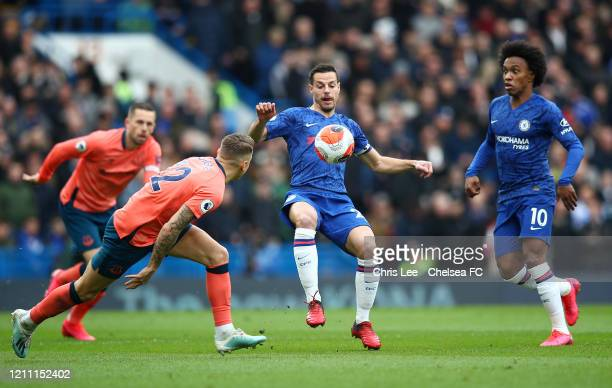 Cesar Azpilicueta of Chelsea battles for possession with Lucas Digne of Everton during the Premier League match between Chelsea FC and Everton FC at...