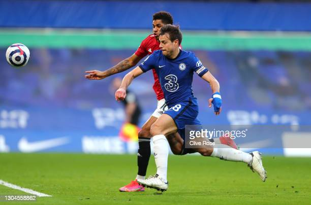 Cesar Azpilicueta of Chelsea battles for possession with Marcus Rashford of Manchester United during the Premier League match between Chelsea and...