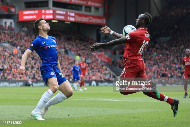 Cesar Azpilicueta of Chelsea battles with Sadio Mane of Liverpool during the Premier League match between Liverpool and Chelsea at Anfield on April...