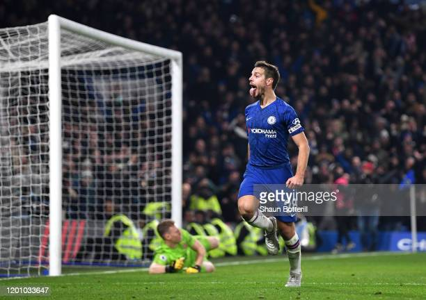 Cesar Azpilicueta of Chelsea celebrates after scoring his team's second goal as Bernd Leno of Arsenal reacts during the Premier League match between...