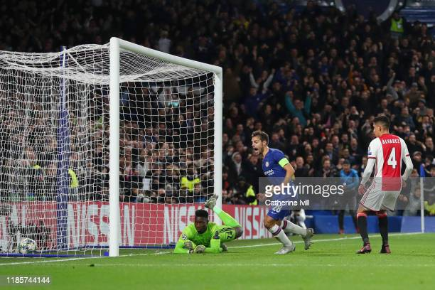 Cesar Azpilicueta of Chelsea celebrates after teammate Reece James scores his team's fourth goal during the UEFA Champions League group H match...