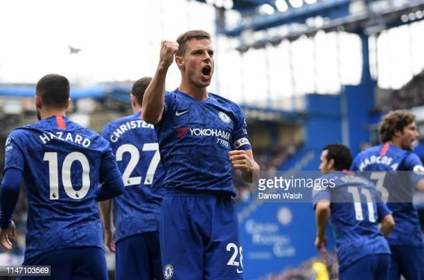 Cesar Azpilicueta of Chelsea celebrates as Ruben LoftusCheek scores his team's first goal during the Premier League match between Chelsea FC and...