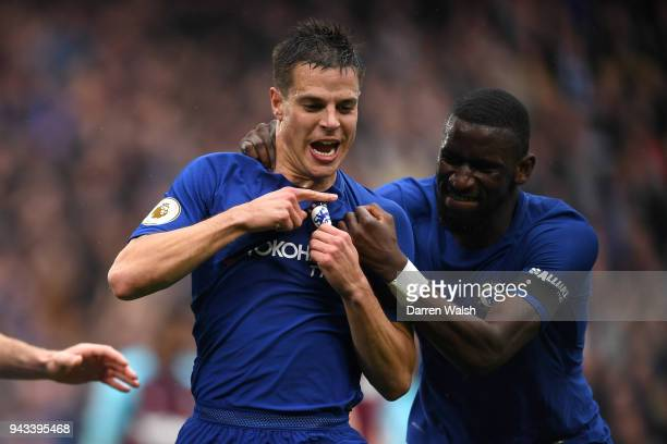 Cesar Azpilicueta of Chelsea celebrates with team mate Antonio Rudiger after scoring his sides first goal during the Premier League match between...