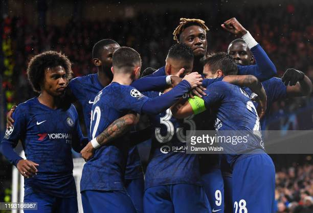 Cesar Azpilicueta of Chelsea celebrates with team mates after scoring his team's second goal during the UEFA Champions League group H match between...