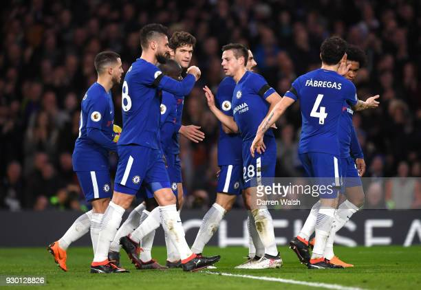 Cesar Azpilicueta of Chelsea celebrates with teamamtes after their sides second goal an own goal by Martin Kelly of Crystal Palace during the Premier...