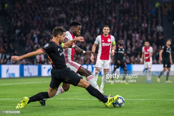 Cesar Azpilicueta of Chelsea challenges for the ball with Quincy Promes of Amsterdam during the UEFA Champions League group H match between AFC Ajax...