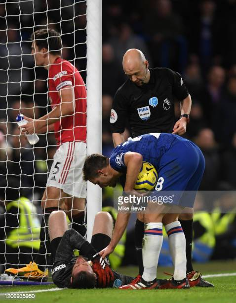 Cesar Azpilicueta of Chelsea checks on an injured David De Gea of Manchester United during the Premier League match between Chelsea FC and Manchester...