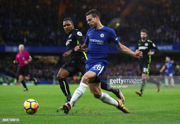 Cesar Azpilicueta of Chelsea clears from Jose Izquierdo of Brighton and Hove Albion during the Premier League match between Chelsea and Brighton and...
