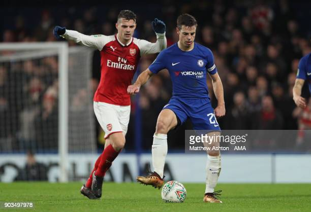 Cesar Azpilicueta of Chelsea competes with Granit Xhaka of Arsenal during the Carabao Cup SemiFinal first leg match between Chelsea and Arsenal at...