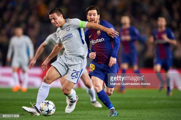 Cesar Azpilicueta of Chelsea FC is challenged by Lionel Messi of FC Barcelona during the UEFA Champions League Round of 16 Second Leg match between...