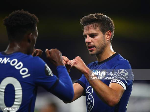 Cesar Azpilicueta of Chelsea fist pumps with Callum Hudson-Odoi during the Premier League match between Chelsea FC and Norwich City at Stamford...