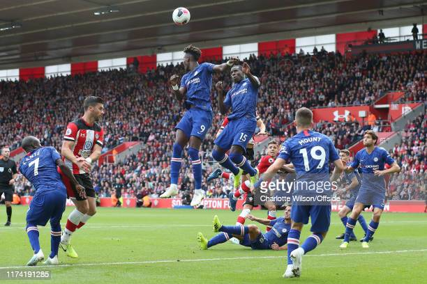 Cesar Azpilicueta of Chelsea goes down in the box as Tammy Abraham and Kurt Zouma miss a header during the Premier League match between Southampton...