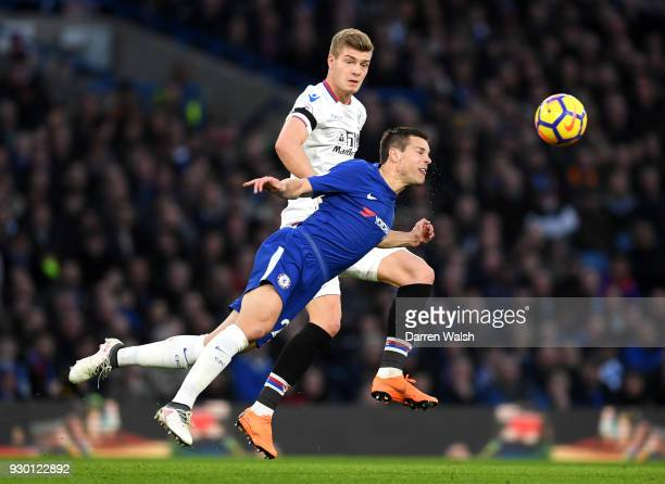 Cesar Azpilicueta of Chelsea heads the ball clear from Alexander Sorloth of Crystal Palace during the Premier League match between Chelsea and...
