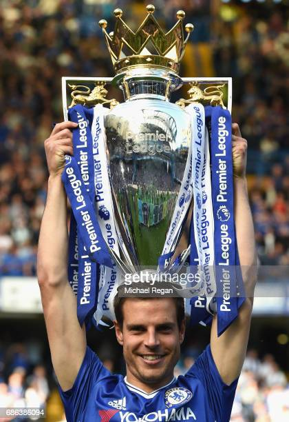Cesar Azpilicueta of Chelsea holds the Premier League Trophy following the Premier League match between Chelsea and Sunderland at Stamford Bridge on...