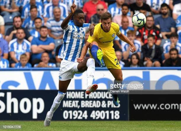 Cesar Azpilicueta of Chelsea is challenged by Adama Diakhaby of Huddersfield Town during the Premier League match between Huddersfield Town and...