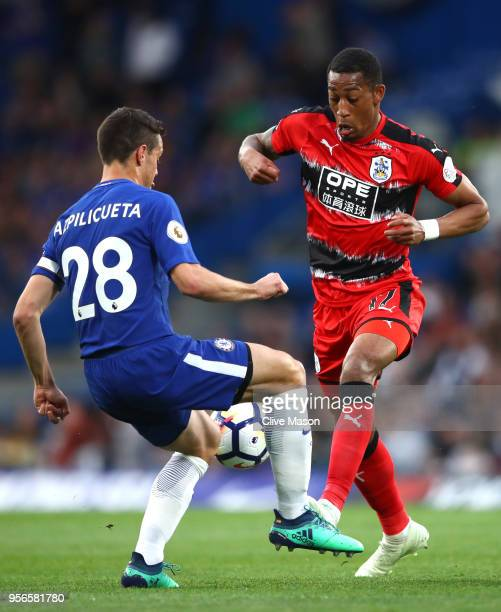 Cesar Azpilicueta of Chelsea is challenged by Rajiv van La Parra of Huddersfield Town during the Premier League match between Chelsea and...