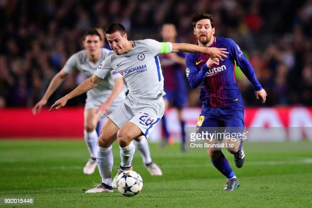 Cesar Azpilicueta of Chelsea is chased by Lionel Messi of FC Barcelona during the UEFA Champions League Round of 16 Second Leg match between FC...