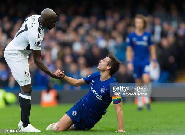 Cesar Azpilicueta of Chelsea is helped up by Aboubakar Kamara of Fulham during the Premier League match between Chelsea FC and Fulham FC at Stamford...