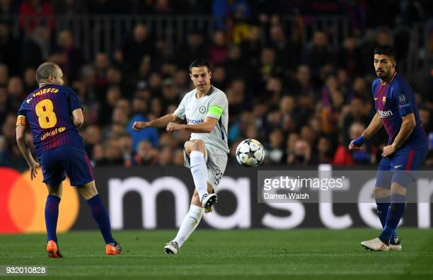 Cesar Azpilicueta of Chelsea is watched by Andres Iniesta and Luis Suarez of Barcelona during the UEFA Champions League Round of 16 Second Leg match...