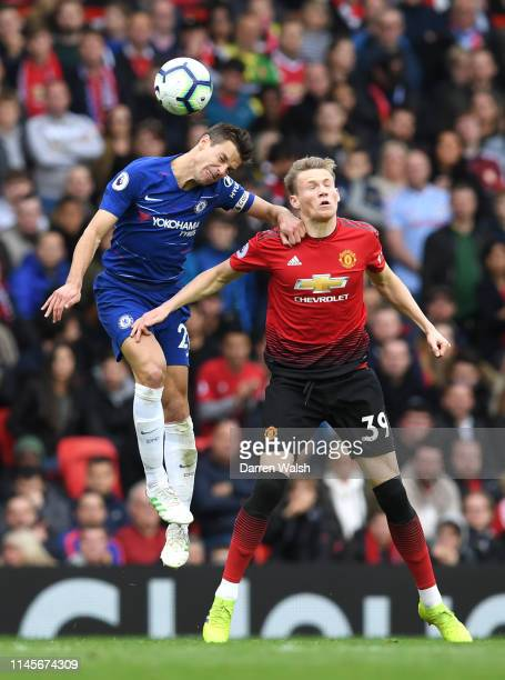 Cesar Azpilicueta of Chelsea jumps with Scott McTominay of Manchester United during the Premier League match between Manchester United and Chelsea FC...