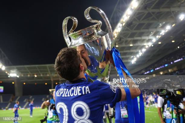 Cesar Azpilicueta of Chelsea kisses the Champions League trophy following victory during the UEFA Champions League Final between Manchester City and...