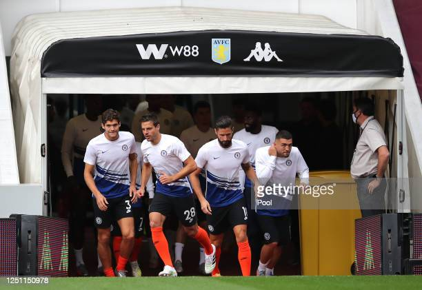Cesar Azpilicueta of Chelsea leads his Chelsea team enter the pitch to warm up ahead of the Premier League match between Aston Villa and Chelsea FC...