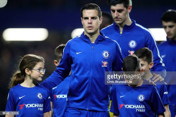 Cesar Azpilicueta of Chelsea leads his team out ahead of the Carabao Cup SemiFinal first leg match between Chelsea and Arsenal at Stamford Bridge on...