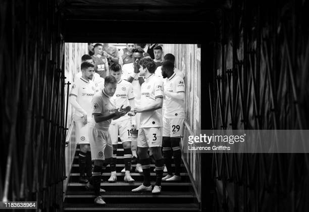 Cesar Azpilicueta of Chelsea leads his team out of the tunnel at half time during the Premier League match between Burnley FC and Chelsea FC at Turf...